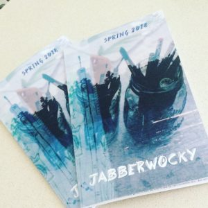 Two copies of Jabberwocky, which have cover art of art supplies in mason jars