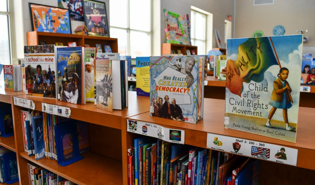 A library's children's bookshelf featuring books about lots of cultures