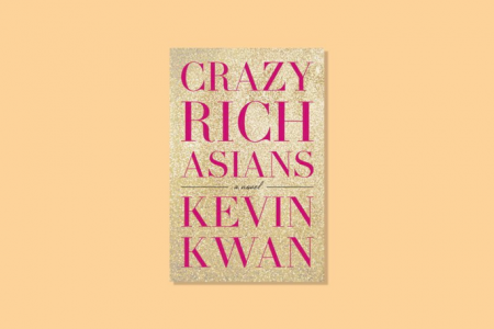 "Yellow background with the cover of ""Crazy Rich Asians"", which is pink text on a background of gold glitter"